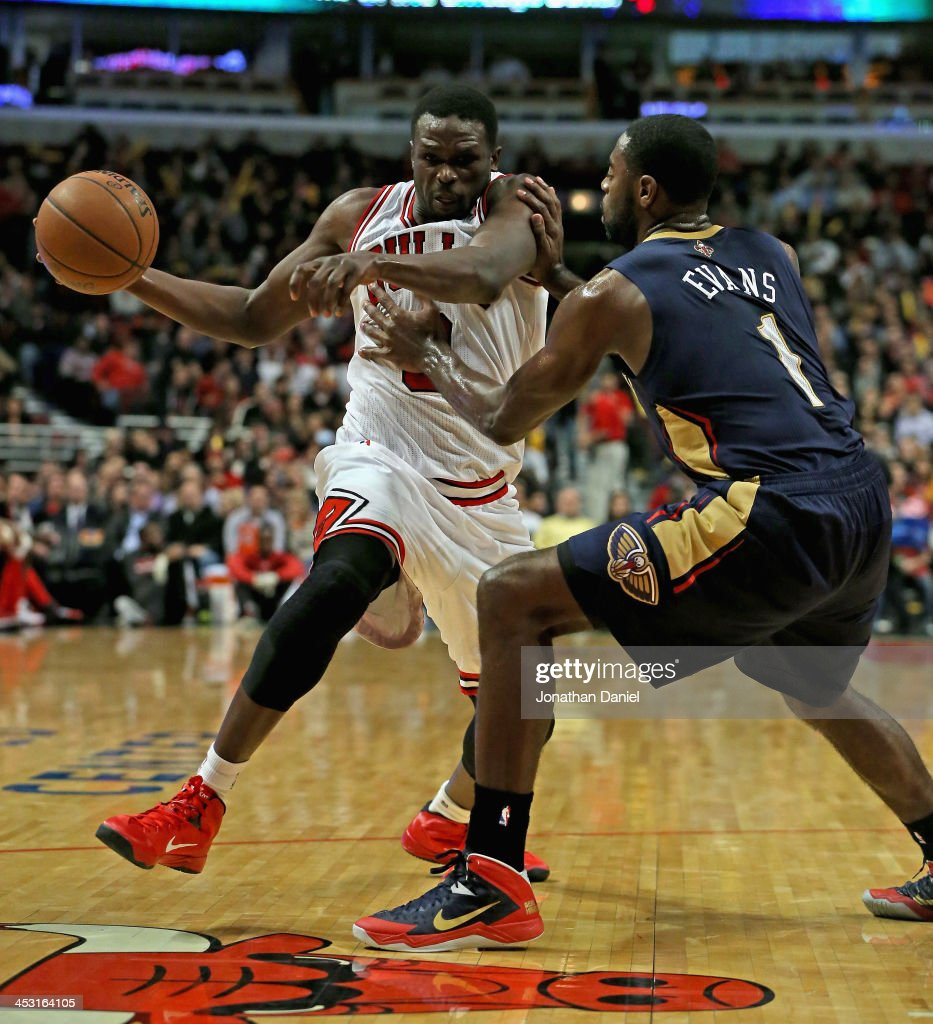 Loul Deng #9 of the Chicago Bulls is shoved by Tyreke Evans #1 of the New Orleans Pelicans at the United Center on December 2, 2013 in Chicago, Illinois.