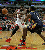 Loul Deng of the Chicago Bulls is shoved by Tyreke Evans of the New Orleans Pelicans at the United Center on December 2 2013 in Chicago Illinois NOTE...