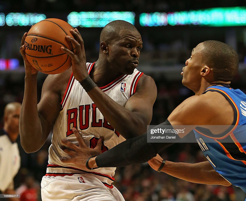 Loul Deng #9 of the Chicago Bulls looks to move against <a gi-track='captionPersonalityLinkClicked' href=/galleries/search?phrase=Russell+Westbrook&family=editorial&specificpeople=4044231 ng-click='$event.stopPropagation()'>Russell Westbrook</a> #0 of the Oklahoma City Thunder at the United Center on November 8, 2012 in Chicago, Illinois.The Thunder defeated the Bulls 97-91.