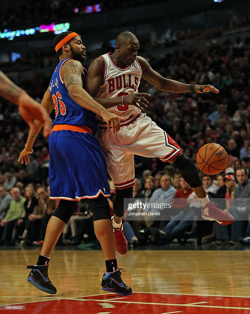 Loul Deng #9 of the Chicago Bulls looses control of the ball under pressure from <a gi-track='captionPersonalityLinkClicked' href=/galleries/search?phrase=Rasheed+Wallace&family=editorial&specificpeople=201483 ng-click='$event.stopPropagation()'>Rasheed Wallace</a> #36 of the New York Knicks at the United Center on December 8, 2012 in Chicago, Illinois. The Bulls defeated the Knicks 93-85.