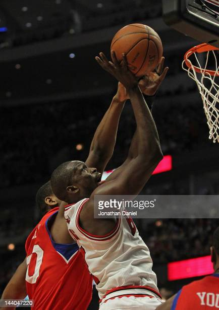 Loul Deng of the Chicago Bulls puts up a shot against Lavoy Allen of the Philadelphia 76ers on his way to a gamehigh 24 points in Game Five of the...