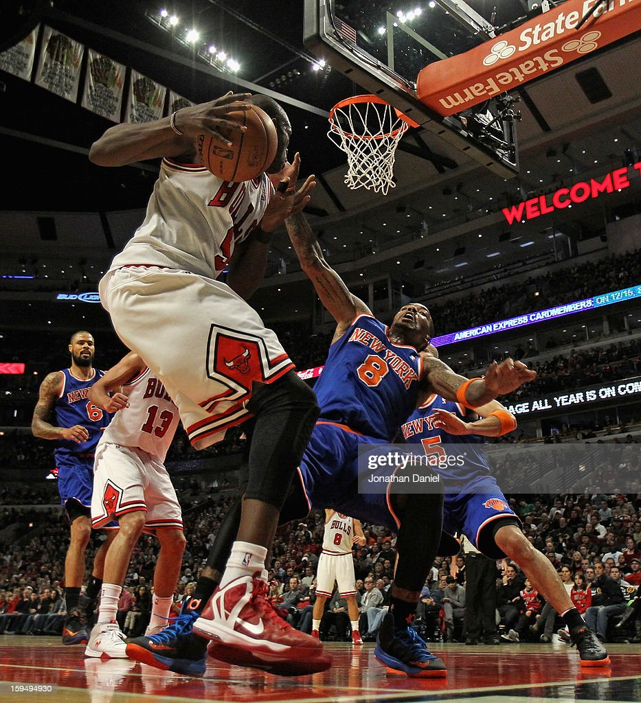 Loul Deng #9 of the Chicago Bulls runs into <a gi-track='captionPersonalityLinkClicked' href=/galleries/search?phrase=J.R.+Smith&family=editorial&specificpeople=201766 ng-click='$event.stopPropagation()'>J.R. Smith</a> #8 of the New York Knicks at the United Center on December 8, 2012 in Chicago, Illinois. The Bulls defeated the Knicks 93-85.