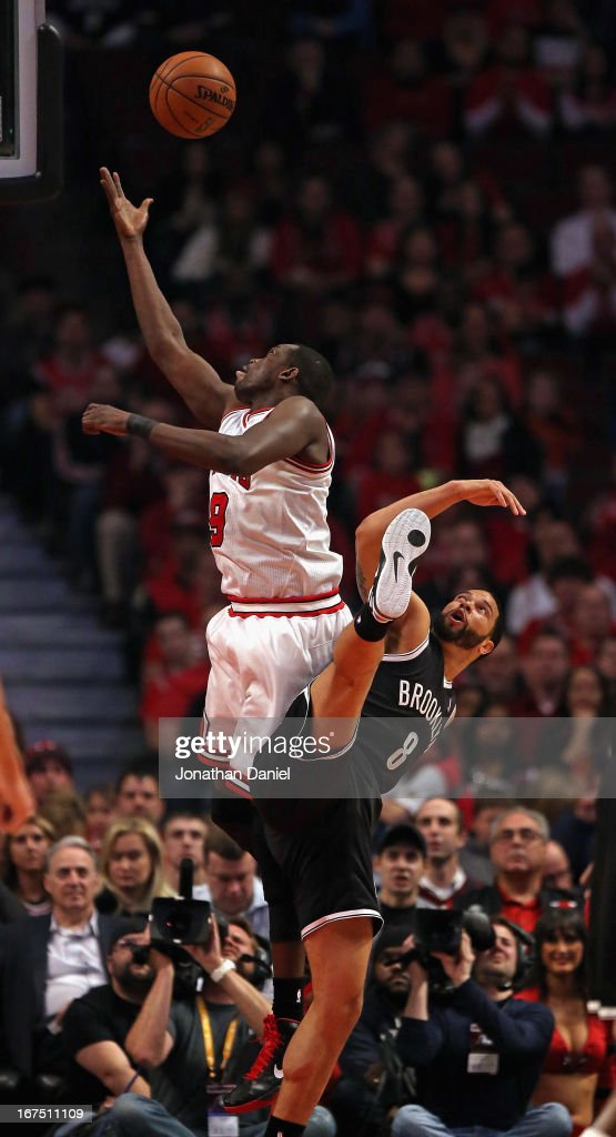 Loul Deng #9 of the Chicago Bulls shoots over <a gi-track='captionPersonalityLinkClicked' href=/galleries/search?phrase=Deron+Williams&family=editorial&specificpeople=203215 ng-click='$event.stopPropagation()'>Deron Williams</a> #8 of the Brooklyn Nets in Game Three of the Eastern Conference Quarterfinals during the 2013 NBA Playoffs at the United Center on April 25, 2013 in Chicago, Illinois.