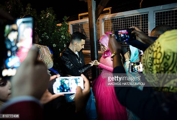Loula a Yemeni refugee and Mohammed a Palestinian refugee from Lebanon exchange rings during their engagement party at the Kofinou centre for...