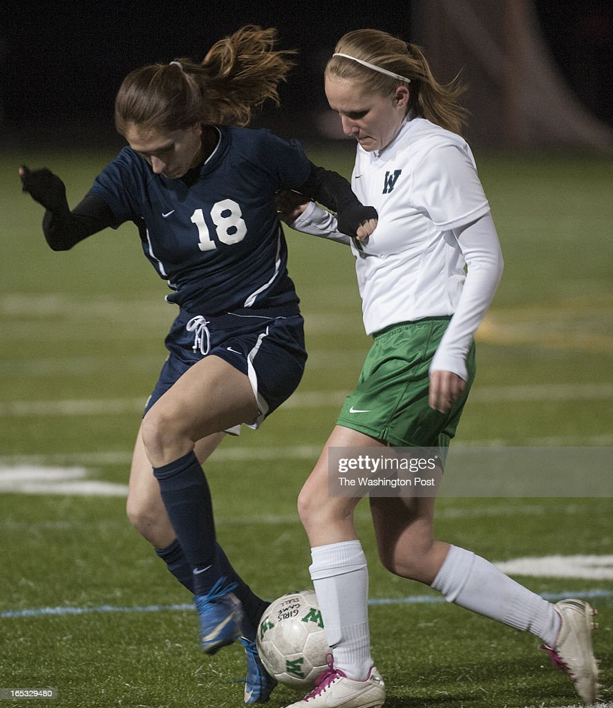 Loundoun County's #18 Shayla Hokland and Woodgrove's #7 Kayleigh McHale fight for controll in the second half at Woodgrove Tuesday April 2, 2013 in Purcelville, VA. Loudoun County won 1-0.
