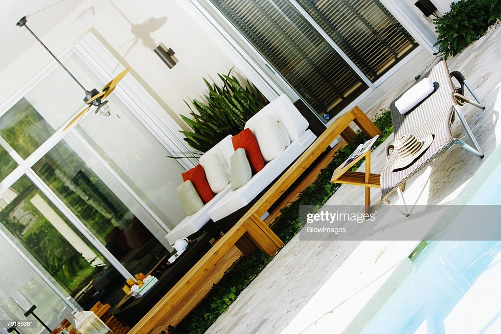 Lounge chair at the poolside : Foto de stock