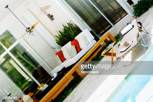 Lounge chair at the poolside : Stock Photo