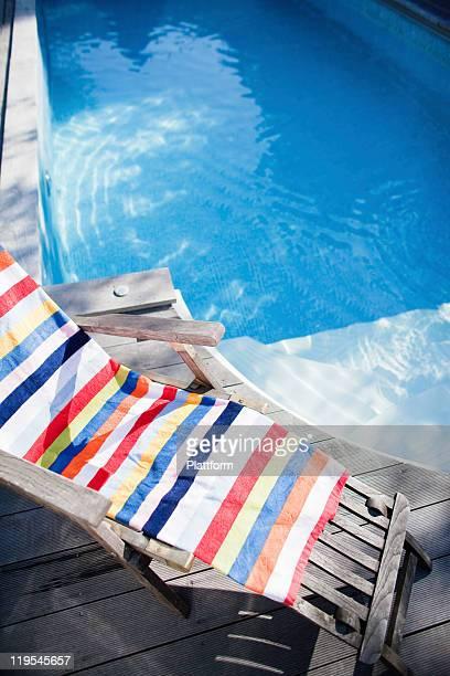 Lounge chair near swimming pool