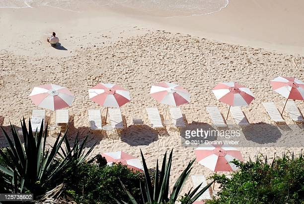 Lounge chairs and sun umbrellas on beach