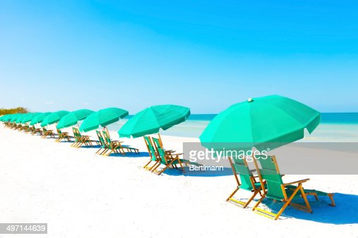 Lounge Chairs And Umbrella At The Beach Photo – Lounge Chair Umbrella