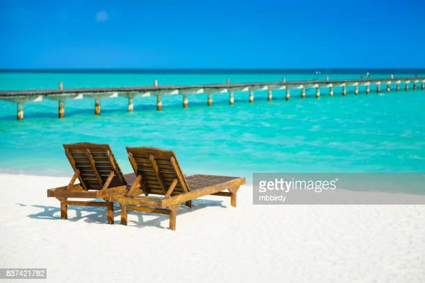 Lounge chairs at Dhiffushi Holiday island, South Ari atoll, Maldives