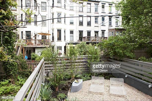 Lounge chairs in urban backyard