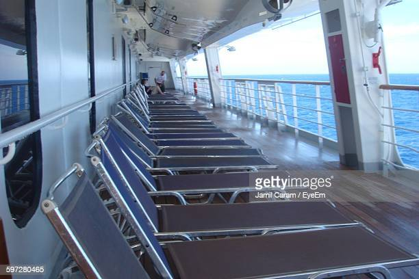 Lounge Chairs On Cruise Ship Sailing In Sea