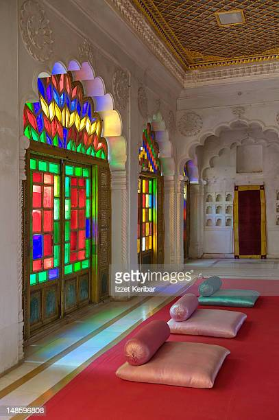 Lounge with stained-glassed doors in Fort.