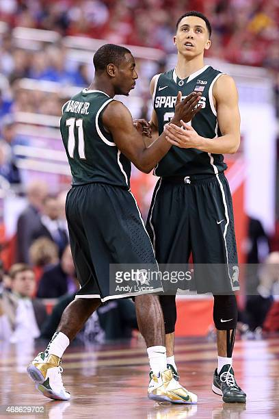 Lourawls Nairn Jr #11 and Travis Trice of the Michigan State Spartans react after a play in the first half against the Duke Blue Devils during the...