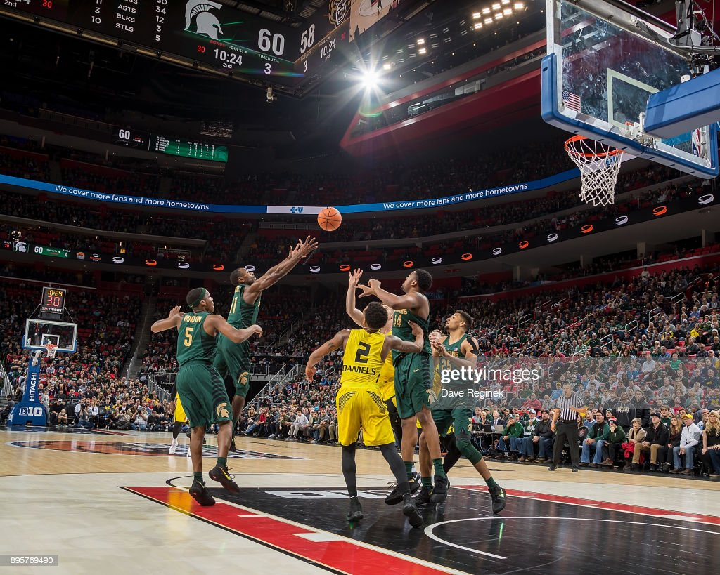 Lourawls Nairn Jr. #11 of the Michigan State Spartans grabs the rebound against the Oakland Golden Grizzlies during game two of the Hitachi College Basketball Showcase at Little Caesars Arena on December 16, 2017 in Detroit, Michigan. The Spartans defeated the Grizzles 86-73.