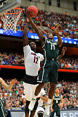 Lourawls Nairn Jr #11 of the Michigan State Spartans shoots the ball against Mangok Mathiang of the Louisville Cardinals in the first half of the...