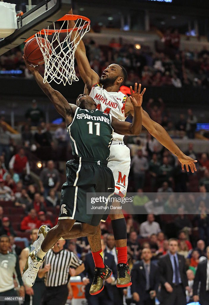 Lourawls Nairn Jr#11 of the Michigan State Spartans goes up for a shot and is fouled by Dez Wells of the Maryland Terrapins during the semifinal...