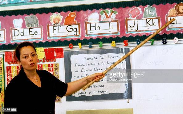 Lourdes Carmona a Spanish speaking first grade teacher instructs a class on the Spanish pronunciations of the alphabet at Birdwell Elementary School...
