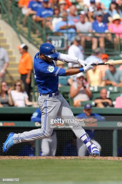 Lourdes Gurriel of the Blue Jays watches his hit sail over the left field fence during the spring training game between the Toronto Blue Jays and the...