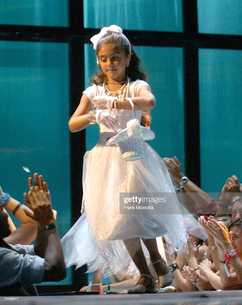 Lourdes Leon, daughter of Madonna dressed in a flower girl dress onstage during the 2003 MTV Video Music Awards at Radio City Music Hall on August 28, 2003 in New York City.