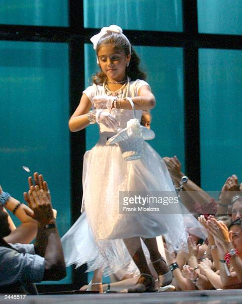 Lourdes Leon daughter of Madonna dressed in a flower girl dress onstage during the 2003 MTV Video Music Awards at Radio City Music Hall on August 28...