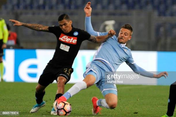 Loureiro Allan of SSC Napoli battles with Sergej Milinkovic Savic of SS Lazio during the Serie A match between SS Lazio and SSC Napoli at Stadio...