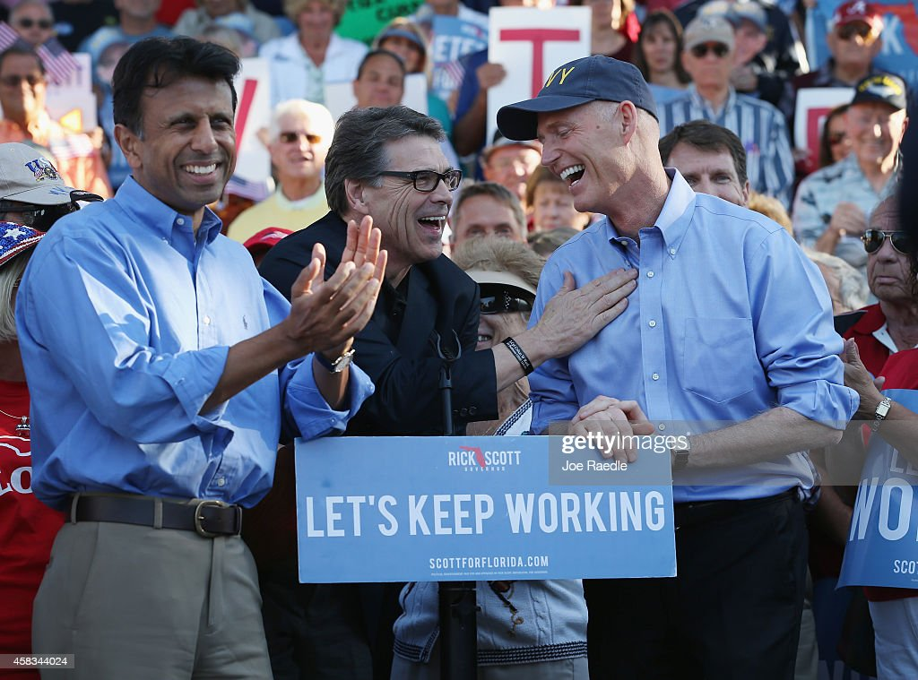 Lousiana Governor <a gi-track='captionPersonalityLinkClicked' href=/galleries/search?phrase=Bobby+Jindal&family=editorial&specificpeople=2249969 ng-click='$event.stopPropagation()'>Bobby Jindal</a> (L) and Texas Governor <a gi-track='captionPersonalityLinkClicked' href=/galleries/search?phrase=Rick+Perry+-+Politician&family=editorial&specificpeople=175872 ng-click='$event.stopPropagation()'>Rick Perry</a> (C) campaign with Florida Governor <a gi-track='captionPersonalityLinkClicked' href=/galleries/search?phrase=Rick+Scott+-+Politician&family=editorial&specificpeople=2370892 ng-click='$event.stopPropagation()'>Rick Scott</a> at The Villages retirement community on November 3, 2014 in The Villages, Florida. Republican Governor <a gi-track='captionPersonalityLinkClicked' href=/galleries/search?phrase=Rick+Scott+-+Politician&family=editorial&specificpeople=2370892 ng-click='$event.stopPropagation()'>Rick Scott</a> is running against former Florida Governor Charlie Crist in the November 4, 2014 election.