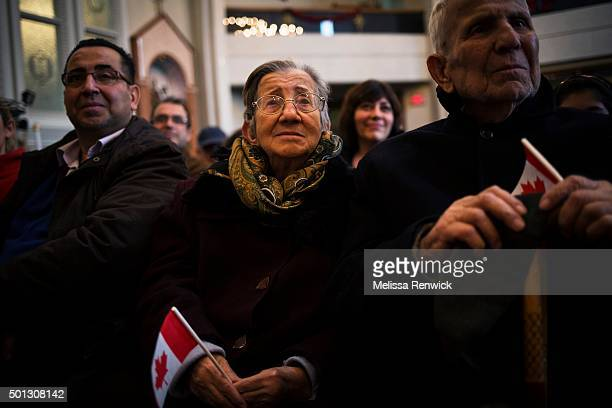 TORONTO ON DECEMBER 11 Lousine Karanjian holds on to a Canadian flag at a welcome mass for Syrian refugees at the Armenian Community Centre in...