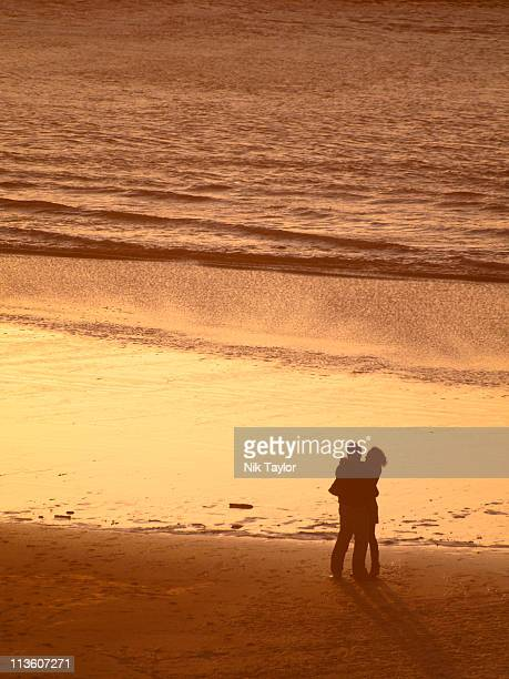 Love and romance on the beach at sunset