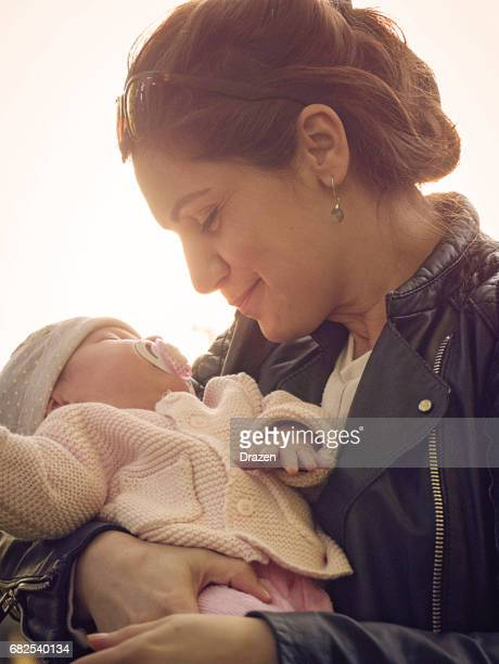 Love and tenderness between millennial generation mother and her baby girl