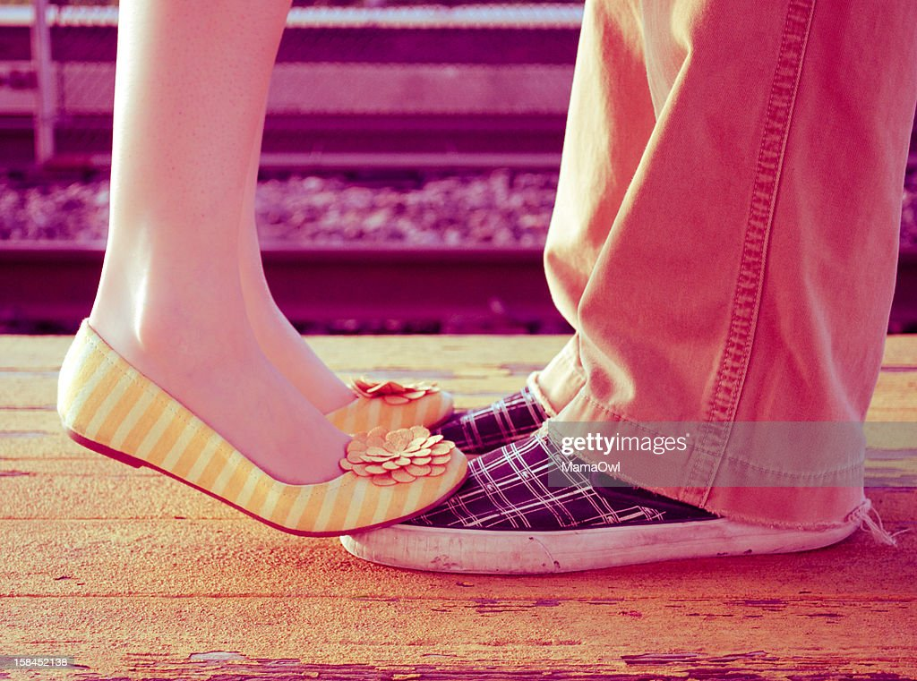 Love at a train station : Stock Photo