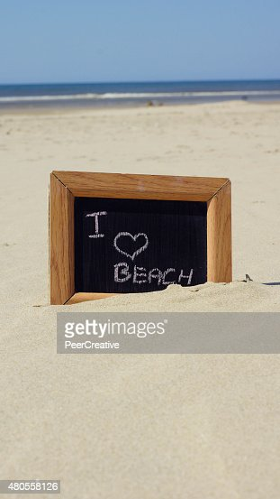 I love beach written : Stock Photo