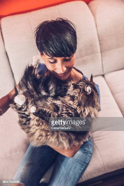 Love Between Woman And Her Adorable Siberian Cat