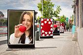 Love billboards, photographs of a woman with red heart, at city street in valentine´s day