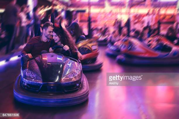 Love birds in bumper car, fair