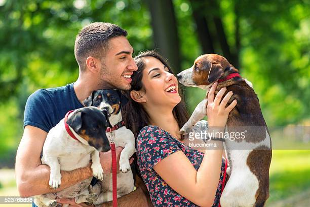 Love couple with their dogs in the park