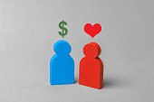 Love for money, prostitution, intimate services. Man with heart and woman with dollar sign. Concept