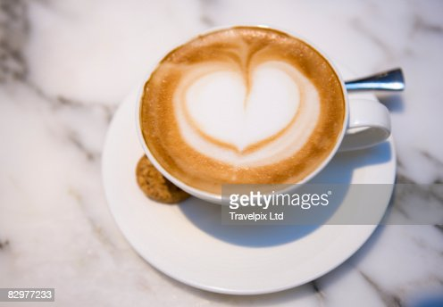 Love heart in froth of cappucino : Stock Photo