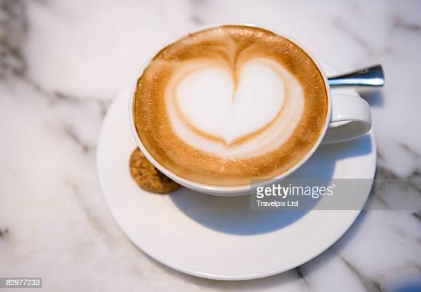Love heart in froth of cappucino