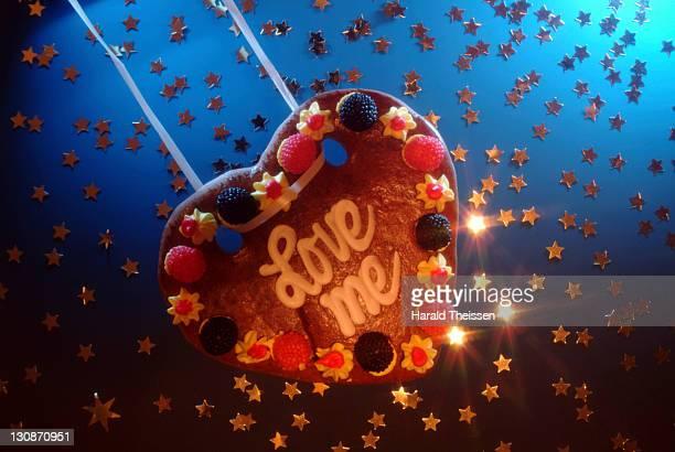 Love heart made of honey cake swinging in stars