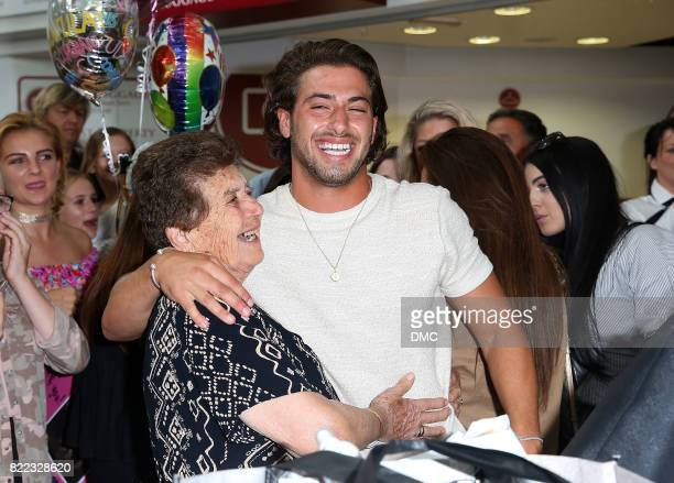 Love Island winner Kem Cetinay is greeted by his grandma as he arrives at Stanstead airport and meets his gran on July 25 2017 in London England