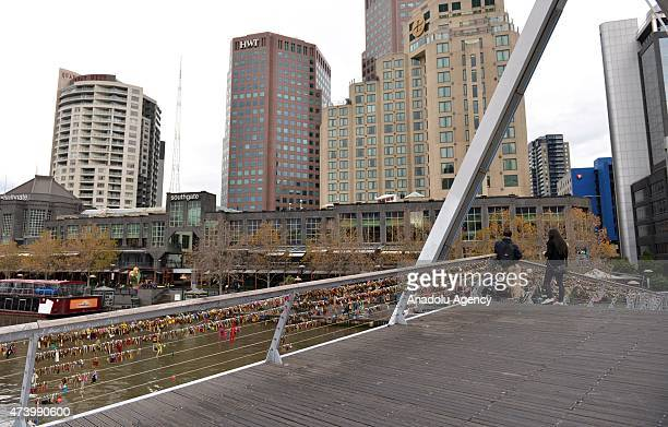 Love locks are seen on the Southgate footbridge in Melbourne on May 19 2015 Thousands of love locks clipped to Melbourne's Southgate footbridge will...