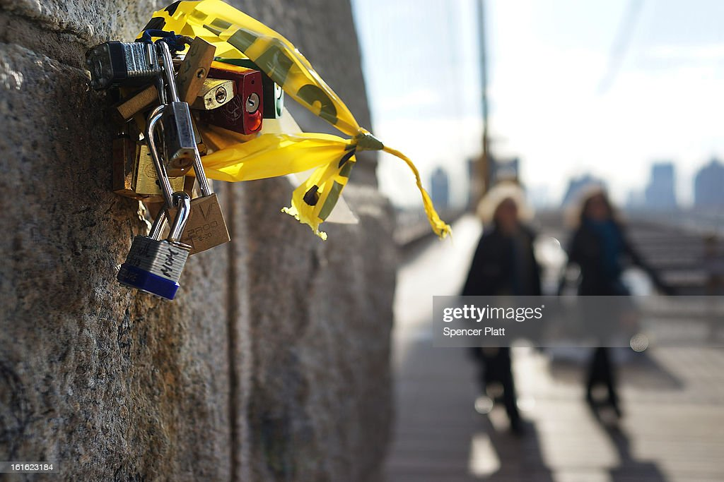 'Love locks' are viewed on the Brooklyn Bridge, one of thousands that have been placed along the bridge recently on February 13, 2013 in New York City. The phenomenon has gained followers in recent years as couples seek to publicly mark weddings, engagements, and anniversaries in a permanent way. Besides New York, 'love locks' can be found on public monuments and bridges in Venice, St. Petersburg and Paris amongst other cities.