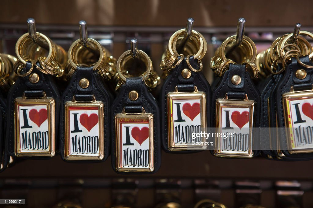 'I love Madrid' key rings hang for sale at a souvenir store in Madrid, Spain, on Friday, June 8, 2012. Spain is poised to become the fourth of the 17 euro-area countries to require emergency assistance as the currency bloc's finance chiefs plan weekend talks on a potential aid request to shore up the nation's lenders. Photographer: Angel Navarrete/Bloomberg via Getty Images