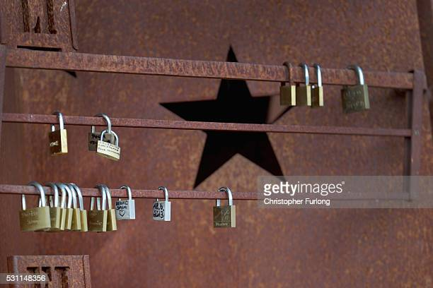 Love padlocks hang from a commemorative sculpture at the dock where the 1985 European Schengen Agreement was signed on May 11 2016 in Schengen...