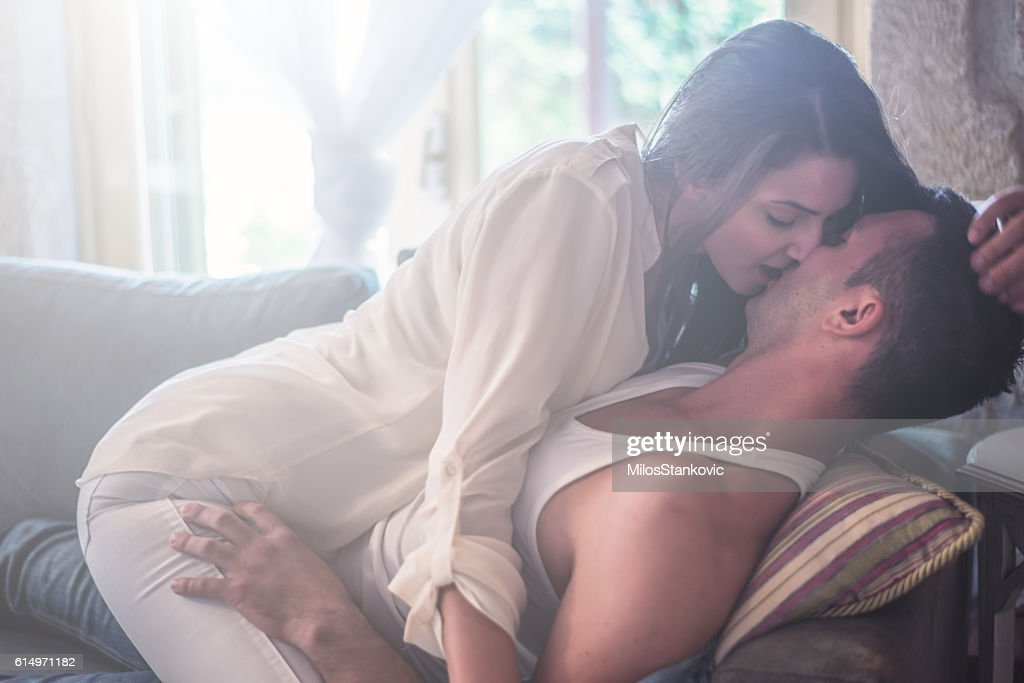Love Passionate Couple at sofa bed : Stock Photo