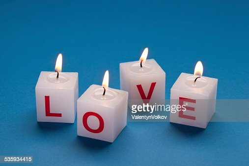 'love' printed on candles. : Stock Photo