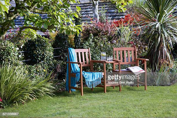 Love seats in a late summer garden