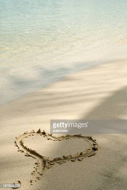Love sign in the sand